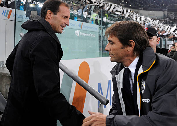 AC Milan's coach Massimiliano Allegri (L) and Juventus' coach Antonio Conte are pictured during the Serie A football match Juventus vs AC Milan on October 6, 2013 in Turin. AFP PHOTO / ALBERTO LINGRIA