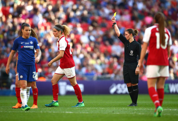 LONDON, ENGLAND - MAY 05: Dominique Janssen of Arsenal is shown a yellow card by referee Lindsey Robinson during the SSE Women's FA Cup Final match between Arsenal Women and Chelsea Ladies at Wembley Stadium on May 5, 2018 in London, England. (Photo by Jordan Mansfield/Getty Images)