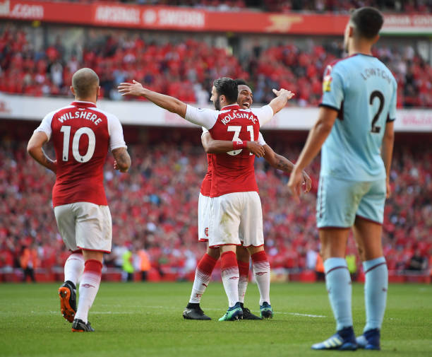 LONDON, ENGLAND - MAY 06: Sead Kolasinac of Arsenal celebrates with Pierre-Emerick Aubameyang of Arsenal after he scores his sides second goal during the Premier League match between Arsenal and Burnley at Emirates Stadium on May 6, 2018 in London, England. (Photo by Mike Hewitt/Getty Images)