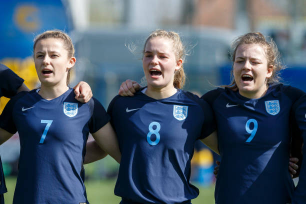 DUNAJSKA LUZNA, SLOVAKIA - APRIL 09: Hannah Cain, Constance Schofield and Lauren Hemp (L-R) of England line up during the national anthem prior to the UEFA Women's Under19 Elite Round match between England and Germany on April 9, 2018 in Dunajska Luzna, Slovakia. (Photo by Christian Hofer/Bongarts/Getty Images)
