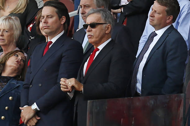 Arsenal's US owner Stan Kroenke (C) looks on during the presentation to Arsenal's French manager Arsene Wenger after the English Premier League football match between Arsenal and Burnley at the Emirates Stadium in London on May 6, 2018. (Photo by Ian KINGTON / IKIMAGES / AFP)