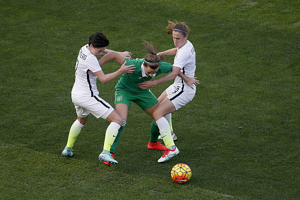 SAN DIEGO, CA - JANUARY 23: Katie McCabe #15 of Ireland is defended by Meghan Klingenberg #7 (L) and Heather O'Reilly #9 (R) of the United States as the United States won 5-0 at Qualcomm Stadium on January 23, 2016 in San Diego, California. (Photo by Todd Warshaw/Getty Images)