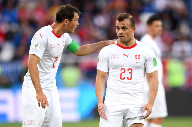 KALININGRAD, RUSSIA - JUNE 22: Stephan Lichtsteiner of Switzerland speaks with Xherdan Shaqiri of Switzerland during the 2018 FIFA World Cup Russia group E match between Serbia and Switzerland at Kaliningrad Stadium on June 22, 2018 in Kaliningrad, Russia. (Photo by Matthias Hangst/Getty Images)