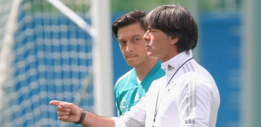 MOSCOW, RUSSIA - JUNE 13: Joachim Loew, head coach of Germany talks to his palyer Mesut Oezil during the Germany training session ahead of the 2018 FIFA World Cup at CSKA Sports Base on June 13, 2018 in Moscow, Russia. (Photo by Alexander Hassenstein/Getty Images)