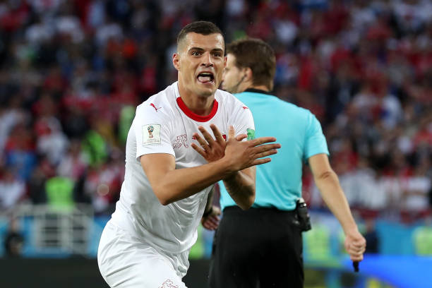 KALININGRAD, RUSSIA - JUNE 22: Granit Xhaka of Switzerland celebrates after scoring his team's first goal during the 2018 FIFA World Cup Russia group E match between Serbia and Switzerland at Kaliningrad Stadium on June 22, 2018 in Kaliningrad, Russia. (Photo by Clive Rose/Getty Images)