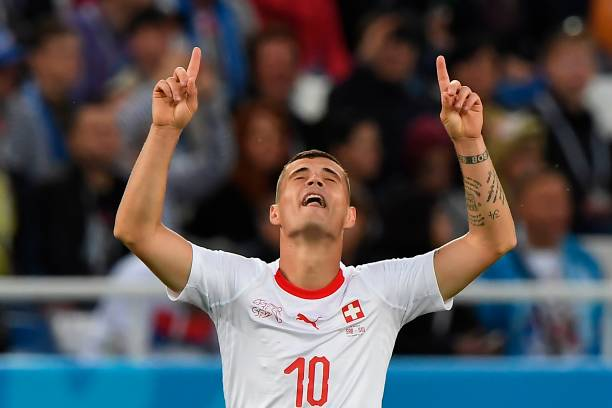 Switzerland's midfielder Granit Xhaka celebrates scoring during their Russia 2018 World Cup Group E football match between Serbia and Switzerland at the Kaliningrad Stadium in Kaliningrad on June 22, 2018. (Photo by Attila KISBENEDEK / AFP)