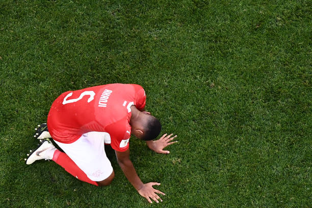 OPSHOT - Switzerland's defender Manuel Akanji looks dejected at the end of the Russia 2018 World Cup round of 16 football match between Sweden and Switzerland at the Saint Petersburg Stadium in Saint Petersburg on July 3, 2018. Sweden won 1-0. (Photo by Jewel SAMAD / AFP)