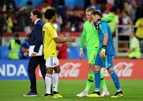 MOSCOW, RUSSIA - JULY 03: Jordan Pickford of England speaks with David Ospina of Colombia and Juan Cuadrado of Colombia after the 2018 FIFA World Cup Russia Round of 16 match between Colombia and England at Spartak Stadium on July 3, 2018 in Moscow, Russia. (Photo by Dan Mullan/Getty Images)