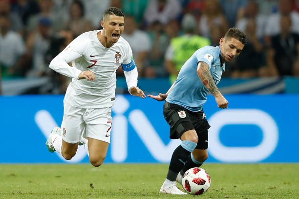 Uruguay's midfielder Lucas Torreira (R) vies for the ball with Portugal's forward Cristiano Ronaldo during the Russia 2018 World Cup round of 16 football match between Uruguay and Portugal at the Fisht Stadium in Sochi on June 30, 2018. (Photo by Odd ANDERSEN / AFP)