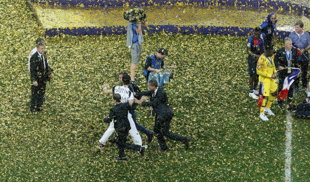 MOSCOW, RUSSIA - JULY 15: Pitch invaders are being taken off the pitch during World Cup trophy presentation following the 2018 FIFA World Cup Final between France and Croatia at Luzhniki Stadium on July 15, 2018 in Moscow, Russia. (Photo by Kevin C. Cox / Getty Images)
