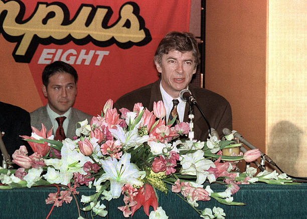 This picture taken on January 31, 1995 shows Arsene Wenger (R), when he was appointed manager of Japanese football club Nagoya Grampus Eight, speaking at his inaugural press conference at a hotel in Nagoya, Aichi prefecture. Nearly 20 years after his brief stay in Japan Arsene Wenger's influence still echoes, following its rise from a backwater of world football to one of its emerging powers. JAPAN OUT AFP PHOTO / JIJI PRESS (