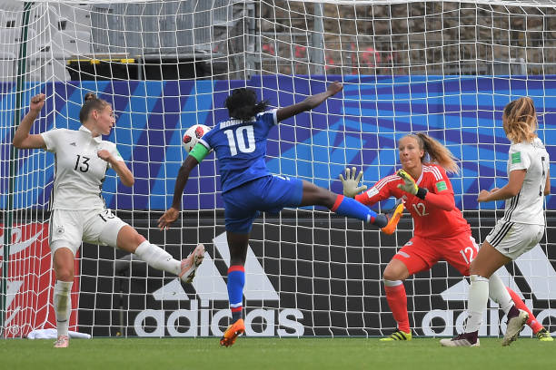 Haiti's forward Nerilia Mondesir (2ndL) scores during the Women's World Cup U20 Group C football match Germany vs Haiti on August 13, 2018, at the Rabine Stadium in Vannes, western France. (Photo by LOIC VENANCE / AFP)