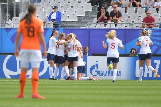 England's players celebrate after scoring during the Women's World Cup U20 quarter final football match between England and Netherlands on August 17, 2018, at the La Rabine Stadium in Vannes, western France. (Photo by LOIC VENANCE / AFP)
