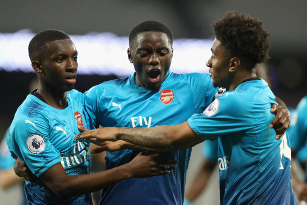 LONDON, ENGLAND - APRIL 20: Edward Nketiah of Arsenal celebrates with teammates Josh Dasilva and Reiss Nelson after scoring his sides third goal during the Premier League 2 match between West Ham United and Arsenal at London Stadium on April 20, 2018 in London, England. (Photo by Linnea Rheborg/Getty Images)