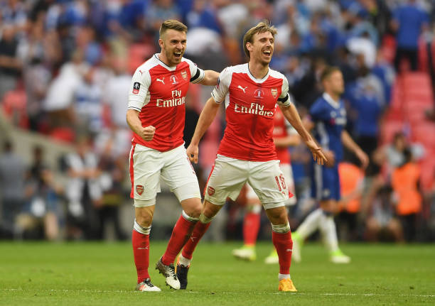 LONDON, ENGLAND - MAY 27: Aaron Ramsey and Nacho Monreal of Arsenal celebrate victory after the Emirates FA Cup Final between Arsenal and Chelsea at Wembley Stadium on May 27, 2017 in London, England. (Photo by Laurence Griffiths/Getty Images)