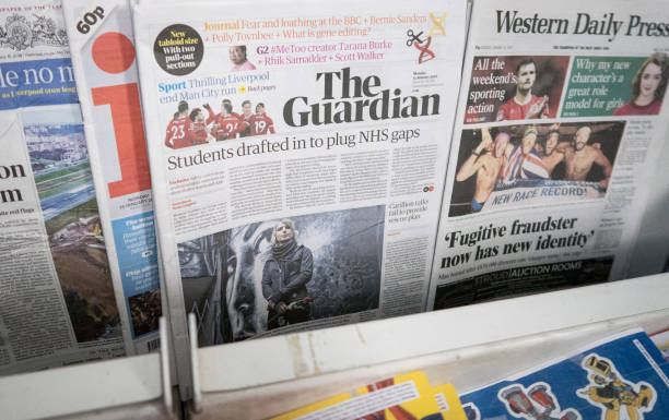 BRISTOL, ENGLAND - JANUARY 15: A copy of the new tabloid sized The Guardian newspaper with its new masthead is pictured for sale on January 15, 2018 in Bristol, England. In a cost-cutting move, publisher Guardian News & Media has ditched the distinctive Berliner size after just over 12 years and outsourced the printing of the tabloid to Trinity Mirror. (Photo by Matt Cardy/Getty Images)