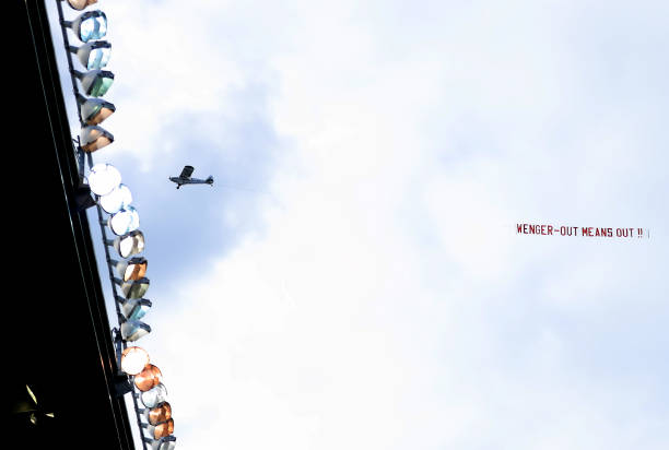 STOKE ON TRENT, ENGLAND - MAY 13: A plane flys over the ground with a banner during the Premier League match between Stoke City and Arsenal at Bet365 Stadium on May 13, 2017 in Stoke on Trent, England. (Photo by Richard Heathcote/Getty Images)