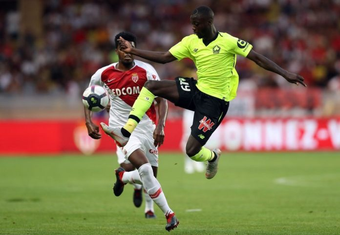 Monaco's Brazilian defender Jemerson (L) fights for the ball with Lille's Ivorian forward Nicolas Pepe (R)during the French L1 football match between Monaco and Lille at the 'Louis II Stadium' in Monaco on August 18, 2018. (Photo credit: VALERY HACHE/AFP/Getty Images)