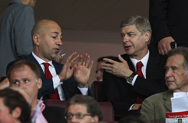 LONDON, ENGLAND - SEPTEMBER 28: Arsene Wenger manager of Arsenal (R) and Ivan Gazidis, CEO of Arsenal (L) in discussion as they sit in the stands prior to the UEFA Champions League Group F match between Arsenal and Olympiacos at the Emirates Stadium on September 28, 2011 in London, England. (Photo by Clive Rose/Getty Images)
