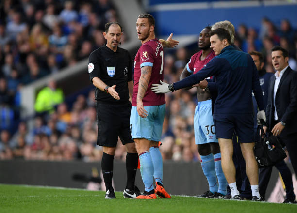 LIVERPOOL, ENGLAND - SEPTEMBER 16: Marko Arnautovic of West Ham United confronts fourth official David Coote during the Premier League match between Everton FC and West Ham United at Goodison Park on September 16, 2018 in Liverpool, United Kingdom. (Photo by Stu Forster/Getty Images)