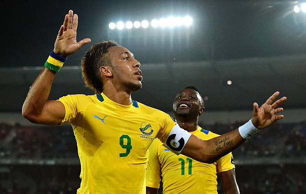 Gabon's forward Pierre-Emerick Aubameyang celebrates after scoring a goal during the 2015 African Cup of Nations group A football match between Burkina Faso and Gabon at Bata Stadium in Bata on January 17, 2015. AFP PHOTO / CARL DE SOUZA
