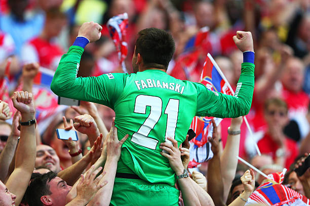 LONDON, ENGLAND - MAY 17:  Lukasz Fabianski of Arsenal celebrates victory with fans after the FA Cup with Budweiser Final match between Arsenal and Hull City at Wembley Stadium on May 17, 2014 in London, England.  (Photo by Clive Mason/Getty Images)