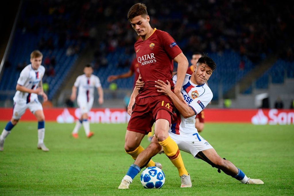 AS Roma Czech forward Patrik Schick (c) holds off CSKA Moscow's Russian midfielder Ilzat Akhmetov during the UEFA Champions League group G stage football match AS Roma vs CSKA Moscow on October 23, 2018 at the Olympic stadium in Rome. (Photo by Filippo MONTEFORTE / AFP) (Photo credit should read FILIPPO MONTEFORTE/AFP/Getty Images)