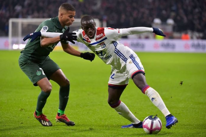Lyon's French defender Ferland Mendy (R) vies with Saint-Etienne's French forward Kevin Monnet Paquet (L) during the French L1 football match between Lyon (OL) and Saint-Etienne (ASSE) on November 23, 2018, at the Groupama Stadium in Decines-Charpieu, near Lyon, central-eastern France. (Photo by ROMAIN LAFABREGUE / AFP / Getty Images)