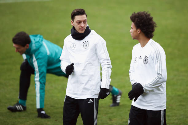 DUESSELDORF, GERMANY - MARCH 21: Mesut Oezil (L) and Leroy Sane chat during a Germany training session ahead of their international friendly match against Spain at Paul-Janes-Stadion on March 21, 2018 in Duesseldorf, Germany. (Photo by Maja Hitij/Bongarts/Getty Images)
