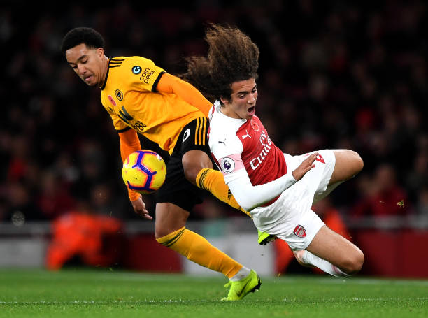 LONDON, ENGLAND - NOVEMBER 11: Matteo Guendouzi of Arsenal is fouled by Helder Costa of Wolverhampton Wanderers during the Premier League match between Arsenal FC and Wolverhampton Wanderers at Emirates Stadium on November 11, 2018 in London, United Kingdom. (Photo by Shaun Botterill/Getty Images)LONDON, ENGLAND - NOVEMBER 11: Matteo Guendouzi of Arsenal is fouled by Helder Costa of Wolverhampton Wanderers during the Premier League match between Arsenal FC and Wolverhampton Wanderers at Emirates Stadium on November 11, 2018 in London, United Kingdom. (Photo by Shaun Botterill/Getty Images)