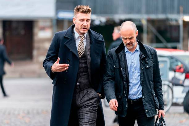 Rosenborg's Danish football player Nicklas Bendtner and lawyer Anders Nemeth arrive for a hearing at Copenhagen City Council on November 2, 2018. - Nicklas Bendtner has been charged with violence against a taxi driver in Copenhagen while the driver has been charged with attempted violence. (Photo by Martin Sylvest / Ritzau Scanpix / AFP) / Denmark OUT (Photo credit should read MARTIN SYLVEST/AFP/Getty Images)