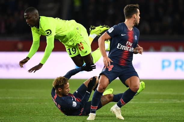Lille's Ivorian forward Nicolas Pepe (up) flies over Paris Saint-Germain's Brazilian forward Neymar (down) after vying for the ball during the French L1 football match between Paris Saint-Germain (PSG) and Lille (LOSC) at the Parc des Princes stadium, in Paris, November 2, 2018. (Photo by FRANCK FIFE / AFP) (Photo credit should read FRANCK FIFE/AFP/Getty Images)