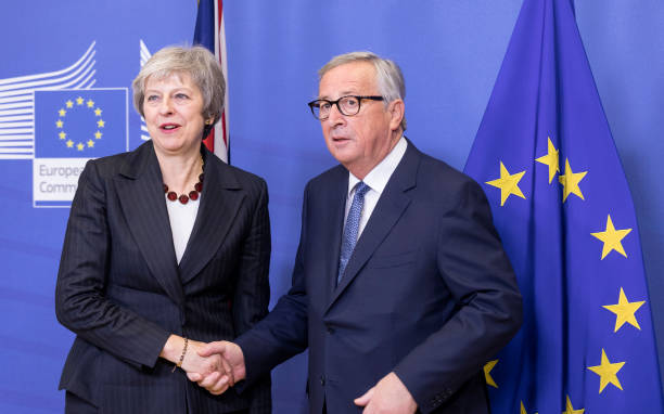 BRUSSELS, BELGIUM - NOVEMBER 21: Prime Minister of the United Kingdom Theresa May (L) is welcomed by the President of the European Commission Jean-Claude Juncker (R) in the Berlaymont, the EU Commission headquarters on November 21, 2018 in Brussels, Belgium. British Prime Minister Theresa May will meet the President of the EU Commission to prepare for the Brexit EU Summit on November 25, 2018 (Photo by Thierry Monasse/Getty Images)