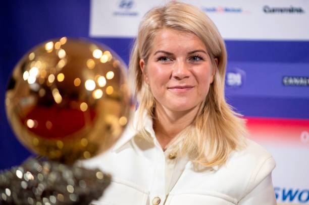 Lyon's Norwegian forward Ada Hegerberg, winner of 2018 Women's Ballon d'Or award for best player of the year, poses with the trophy during a press conference with Lyon's President at the Groupama training center in Lyon, central eastern France, on December 4, 2018. - Awarded the Golden Ball on December 3, Hegerberg is the first woman who won the price. (Photo by ROMAIN LAFABREGUE / AFP)