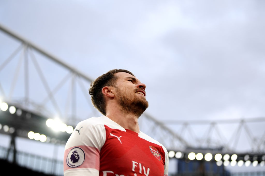 LONDON, ENGLAND - DECEMBER 02: Aaron Ramsey of Arsenal reacts during the Premier League match between Arsenal FC and Tottenham Hotspur at Emirates Stadium on December 1, 2018 in London, United Kingdom. (Photo by Shaun Botterill/Getty Images)