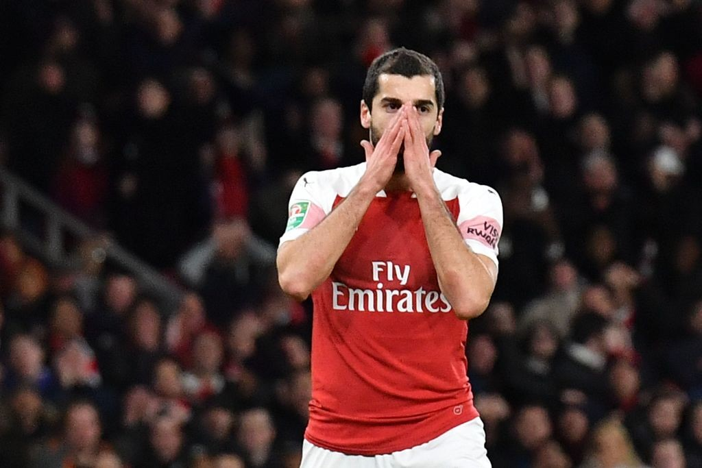 Arsenal's Armenian midfielder Henrikh Mkhitaryan reacts during the English League Cup quarter-final football match between Arsenal and Tottenham Hotspur at the Emirates Stadium in London on December 19, 2018. (Photo by Ben STANSALL / AFP / Getty Images)