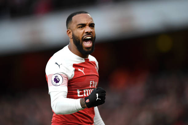LONDON, ENGLAND - DECEMBER 02: Alexandre Lacazette of Arsenal celebrates during the Premier League match between Arsenal FC and Tottenham Hotspur at Emirates Stadium on December 1, 2018 in London, United Kingdom. (Photo by Shaun Botterill/Getty Images)