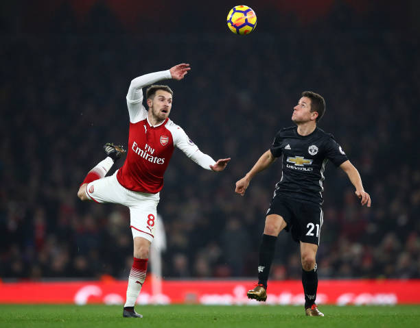 LONDON, ENGLAND - DECEMBER 02: Aaron Ramsey of Arsenal in action with Ander Herrera of Manchester United during the Premier League match between Arsenal and Manchester United at Emirates Stadium on December 2, 2017 in London, England. (Photo by Julian Finney/Getty Images)