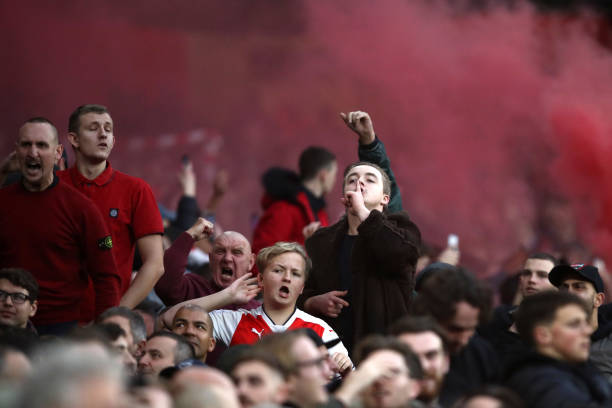 LONDON, ENGLAND - DECEMBER 02: Arsenal fans celebrate during the Premier League match between Arsenal FC and Tottenham Hotspur at Emirates Stadium on December 1, 2018 in London, United Kingdom. (Photo by Julian Finney/Getty Images)
