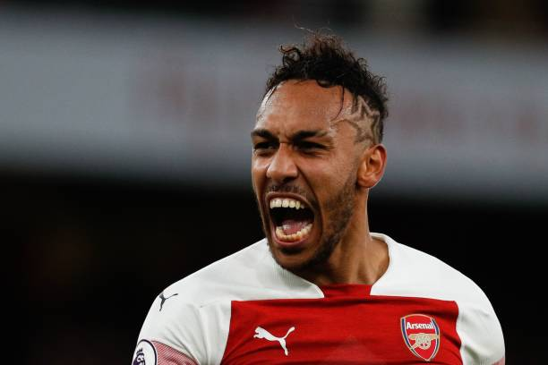 Arsenal's Gabonese striker Pierre-Emerick Aubameyang celebrates on the pitch after the English Premier League football match between Arsenal and Tottenham Hotspur at the Emirates Stadium in London on December 2, 2018. - Arsenal won the game 4-2. (Photo by Adrian DENNIS /