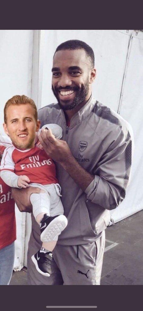 Alexandre Lacazette Holding Harry Kane Like A Baby