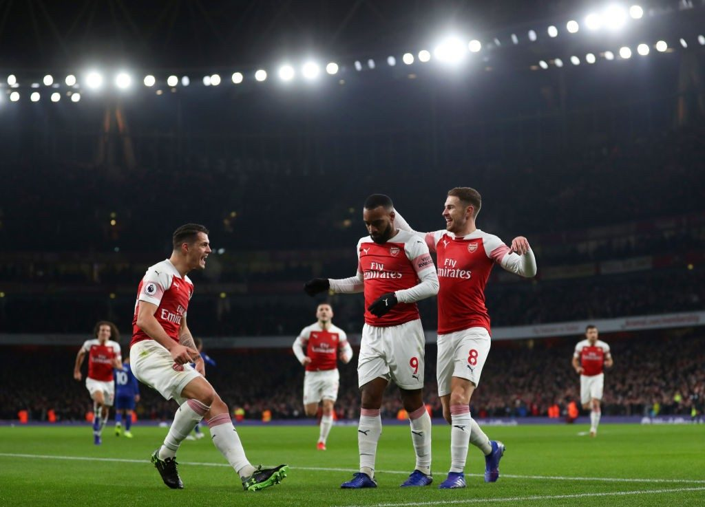 LONDON, ENGLAND - JANUARY 19: Alexandre Lacazette of Arsenal celebrates scoring his teams first goal with Granit Xhaka and Aaron Ramsey during the Premier League match between Arsenal FC and Chelsea FC at Emirates Stadium on January 19, 2019 in London, United Kingdom. (Photo by Catherine Ivill/Getty Images)
