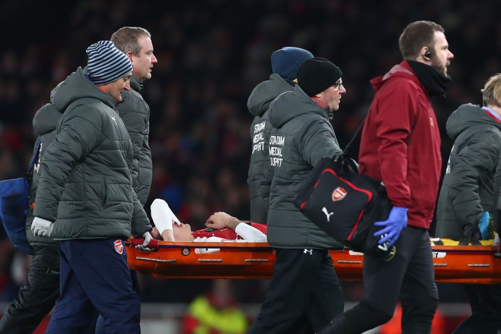 LONDON, ENGLAND - JANUARY 19: Hector Bellerin of Arsenal is stretchered off after receiving medical treatment during the Premier League match between Arsenal FC and Chelsea FC at Emirates Stadium on January 19, 2019 in London, United Kingdom. (Photo by Clive Rose/Getty Images)