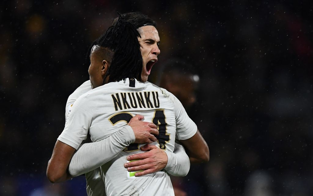 Paris Saint-Germain's Uruguayan forward Edinson Cavani (L) is congratulated by Paris Saint-Germain's French midfielder Christopher Nkunku after scoring a goal during the French League Cup round of sixteen football match Orleans vs Paris Saint-Germain (PSG), on December 18, 2018 at La Source stadium in Orleans. (Photo by FRANCK FIFE / AFP / Getty Images)