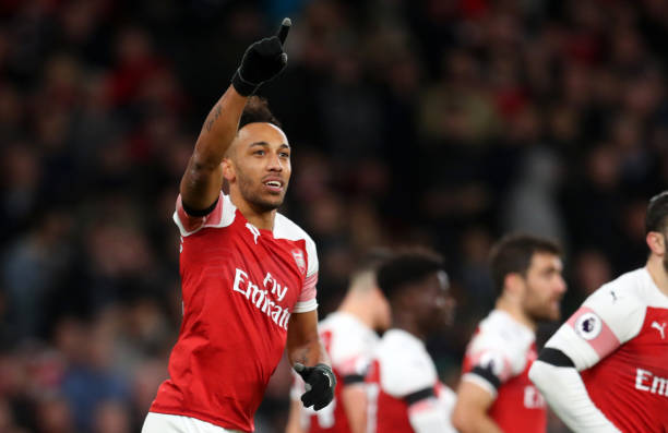 LONDON, ENGLAND - JANUARY 01: Pierre-Emerick Aubameyang of Arsenal celebrates after scoring his team's fourth goal during the Premier League match between Arsenal FC and Fulham FC at Emirates Stadium on January 1, 2019 in London, United Kingdom. (Photo by Catherine Ivill/Getty Images)
