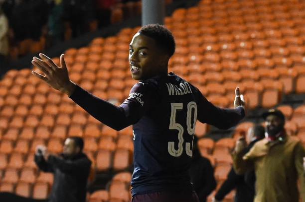 Arsenal's English midfielder Joe Willock celebrates scoring his and Arsenal's second goal during the English FA Cup third round football match between Blackpool and Arsenal at Bloomfield Road in Blackpool, north west England on January 5, 2019. (Photo by Paul ELLIS / AFP)