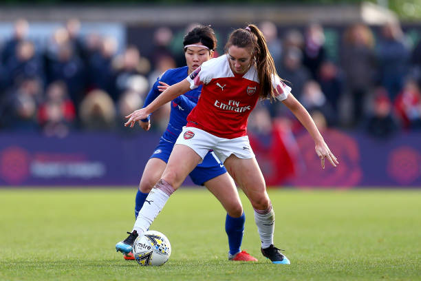 BOREHAMWOOD, ENGLAND - JANUARY 13: Lisa Evans of Arsenal Women tackles with Ji So Yun of Chelsea Women during the FA WSL match between Arsenal Women and Chelsea Women at Meadow Park on January 13, 2019 in Borehamwood, England. (Photo by Jordan Mansfield/Getty Images)