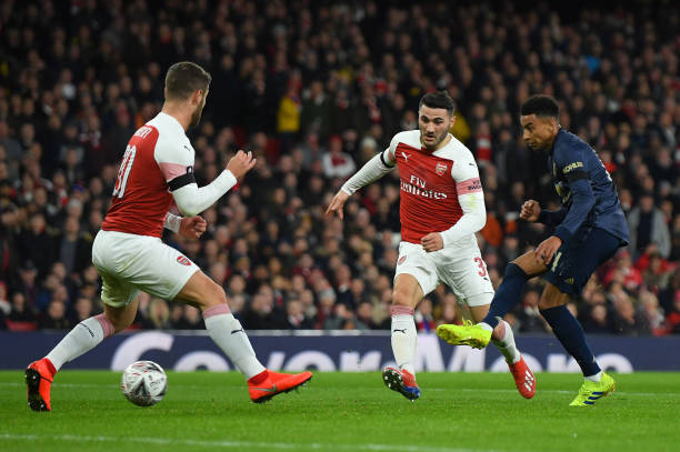 LONDON, ENGLAND - JANUARY 25:  Jesse Lingard of Manchester United scores scores his team's second goal as Sead Kolasinac and Shkodran Mustafi of Arsenal look on during the FA Cup Fourth Round match between Arsenal and Manchester United at Emirates Stadium on January 25, 2019 in London, United Kingdom. (Photo by Mike Hewitt/Getty Images)