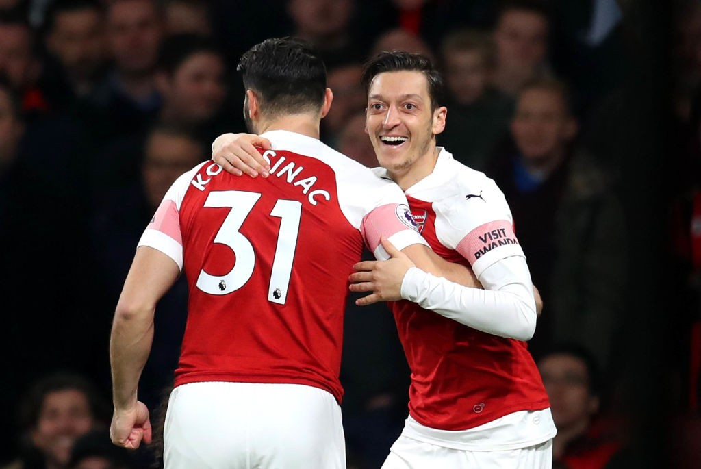 LONDON, ENGLAND - FEBRUARY 27: Mesut Ozil of Arsenal celebrates after scoring his team's first goal with Sead Kolasinac of Arsenal during the Premier League match between Arsenal FC and AFC Bournemouth at Emirates Stadium on February 27, 2019 in London, United Kingdom. (Photo by Catherine Ivill/Getty Images)