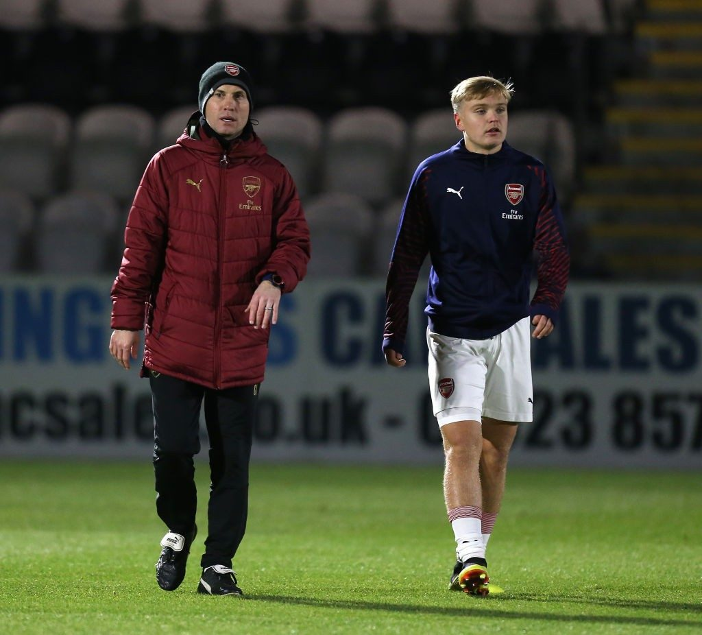 BOREHAMWOOD, ENGLAND - DECEMBER 12: Arsenal U18 coach Greg Lincoln with Matthew Smith prior to the FA Youth Cup 3rd Round match between Arsenal U18 and Northampton Town U18 at Meadow Park on December 12, 2018 in Borehamwood, England. (Photo by Pete Norton/Getty Images)